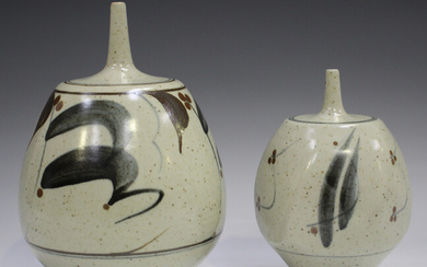 Two Derek Clarkson studio pottery vases, each with a narrow neck above a bulbous body, the oatmeal g