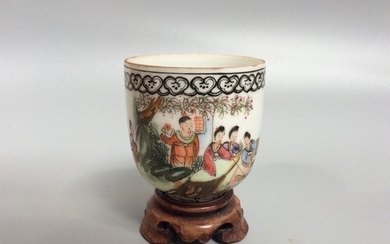 A 20th century Chinese porcelain wine cup, painted in polych...