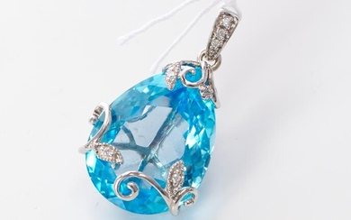 A BLUE TOPAZ AND DIAMOND PENDANT IN 9CT WHITE GOLD, OF FOLIATE DESIGN, THE PEAR CUT TOPAZ WEIGHING 25.58CTS, LENGTH 30MM
