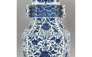 A CHINESE BLUE AND WHITE ZUN VASE, decorated with lotus flow...