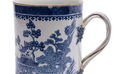A Chinese blue and white mug: of cylindrical form with plait...