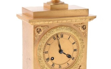 A French gilt metal mantel clock in Empire style