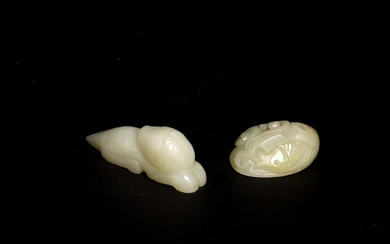 A GROUP OF TWO WHITE JADE TOGGLES