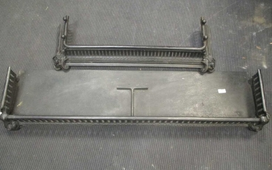 A black pierced steel fender 132cm wide together with a cast iron fender, 93cm wide (2)