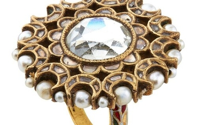 A gold mirror ring, India, 19th century, of floral shape inlaid with mirror and diamonds, the reverse with enamelled floral decoration in red, blue green and white and the circumference strung with pearls, ring size O, 3.4cm. diam., weight 26 grams