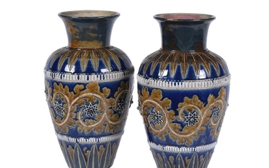 A pair of Doulton Lambeth stoneware shouldered ovoid vases by George Tinworth