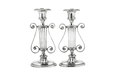 A pair of Edwardian sterling silver candlesticks