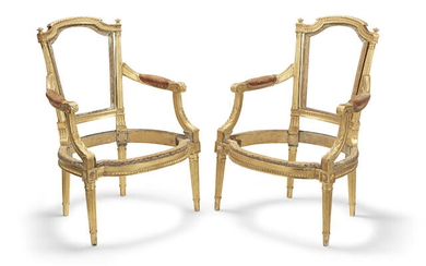 A pair of Louis XVI un-upholstered giltwood fauteuils or open armchairs