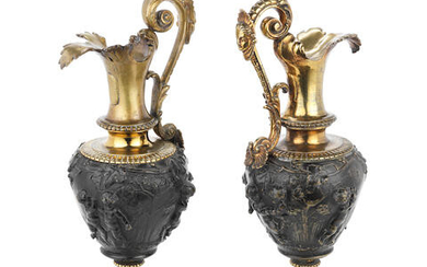 A pair of late 19th century gilt and patinated bronze garniture ewers