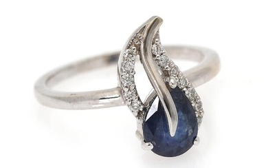 NOT SOLD. A ring set with a sapphire and numerous diamonds, mounted in 14k white gold. W. app. 15 mm. Size 54. – Bruun Rasmussen Auctioneers of Fine Art
