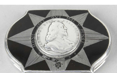 A silver mounted tortoiseshell snuff box, inset with a Charles I silver memorial medal.
