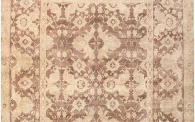ANTIQUE SOFT AND MUTED INDIAN AGRA CARPET. 11 ft 8 in x 9 ft 2 in (3.56 m x 2.79 m).