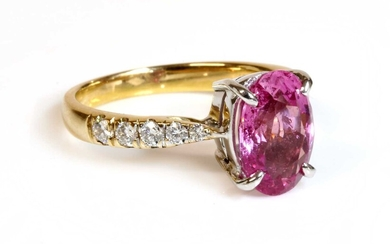 An 18ct gold pink sapphire and diamond ring