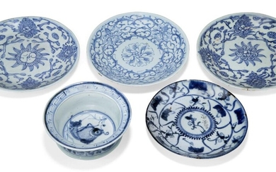 Five pieces of Chinese blue and white porcelain, 19th century, comprising four saucer dishes decorated with floral sprays, 18cm diameter, and a bowl painted to the central reserve with a fish, 13.5cm diameter
