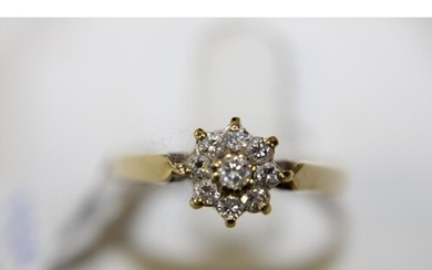 A 18ct gold diamond cluster ring size N