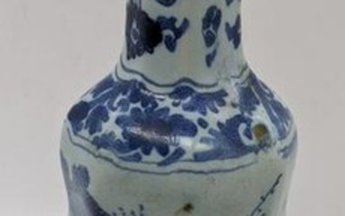 A 19th century or earlier Delft blue and white vase