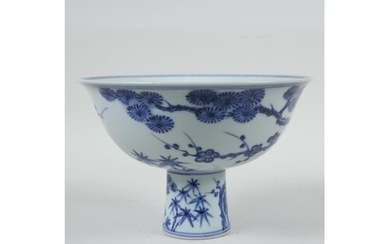 A Chinese blue and white porcelain stem bowl with cypress tr...