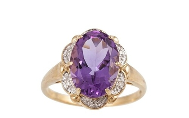 A DIAMOND AND AMETHYST CLUSTER RING, the oval amethyst to di...