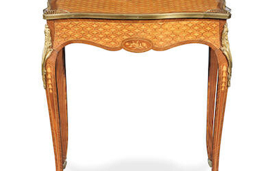 A French late 19th century gilt bronze mounted kingwood, tulipwood and inlaid serpentine side table