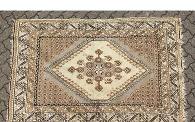 A PERSIAN RUG brown and cream with large medallions. 6ft 6in...
