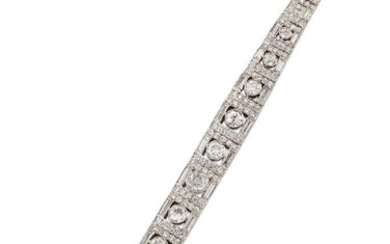 A diamond bracelet, composed of a series of brilliant and baguette-cut diamond graduated square panels, the front eleven set with graduated old brilliant or brilliant-cut diamond single stones, length 18.5cm