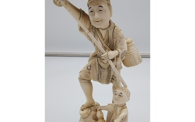 A large 19th century Japanese Ivory figure of an elderly gen...