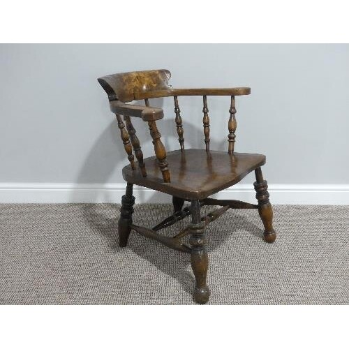 A late 19thC ash and elm smokers bow Armchair, with spindle ...