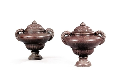 A pair of Roman Baroque style porphyry covered urns