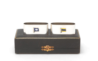 A pair of silver and enamel signal flag napkin rings