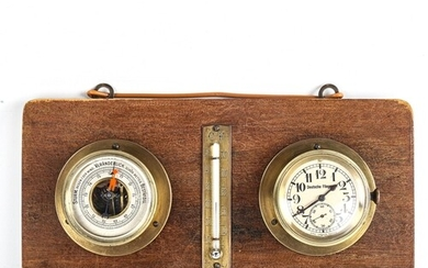 A wall-hanging combination aircraft clock/barometer/thermome...