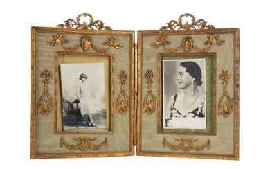 AN EARLY 20TH CENTURY ORMOLU DOUBLE PICTURE FRAME