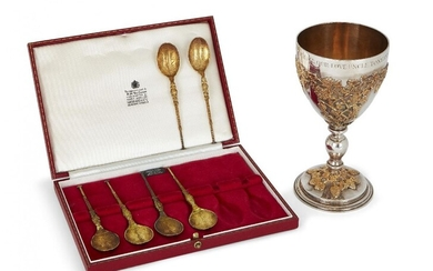 An Apsrey & Co. silver goblet with gilt fruiting vine overlay, London, c.1972, designed with knopped stem and gilt decoration to body and stepped foot, the rim with personalised engraving, together with a cased set of six silver gilt replica...