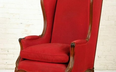 FRENCH CARVED MAHOGANY UPHOLSTERED WING CHAIR