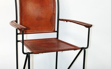 Leather armchair with wrought iron frame