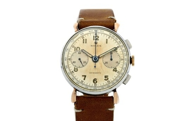 Rolex, REFERENCE 4099 A STAINLESS STEEL AND PINK GOLD CHRONOGRAPH WRISTWATCH WITH FLARED LUGS, CIRCA 1938