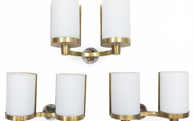 NOT SOLD. Rolf Graae: Set of three wall lamps of brass, each with two sockets. Cylinder shaped shades of opal glass. (3) – Bruun Rasmussen Auctioneers of Fine Art