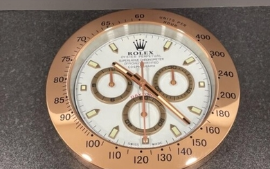 Rose gold colour wall clock in the style of Rolex