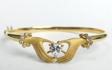 18ct gold hands holding a heart design stone set hinged bang...