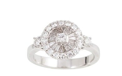 A DIAMOND CLUSTER RING, set with brilliant and baguette cut ...