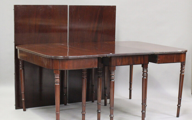 A George III mahogany dining table with central additional section and two extra leaves, on turned l