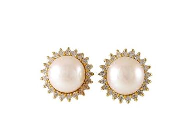 A PAIR OF CULTURED PEARL EARRINGS, with diamond surrounds