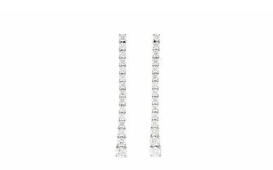 A PAIR OF DIAMOND DROP EARRINGS, each comprising of a line o...