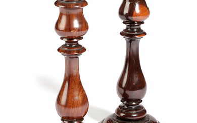 A PAIR OF EARLY VICTORIAN TREEN LIGNUM VITAE CANDLESTICKS