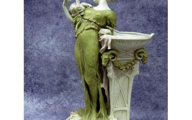 A Royal Dux Pottery Model of a Lady, standing with a cherub ...