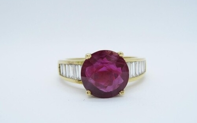 A Ruby and Diamond Ring claw-set round ruby, 3.26cts between...