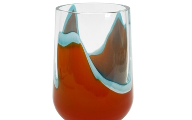 A Seguso thick glass vase with irregular orange and milky-blue decoration. Signed