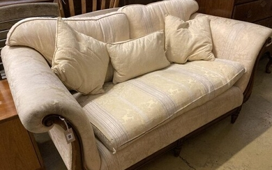 A Victorian style mahogany two seater scroll arm settee, wid...