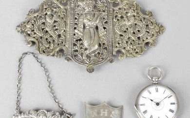 A collection of assorted items to include an Indian pierced metal belt buckle, silver fob watch and decanter label.