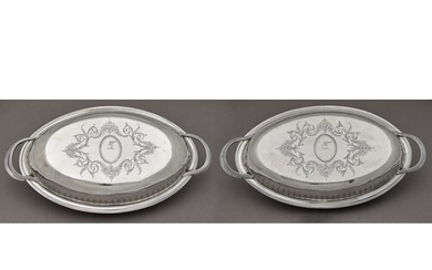 A pair of George III oval silver entree dishes and covers, e...