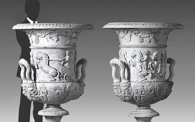 A pair of monumental Italian sculpted white marble urns in the manner of the Medici Vase